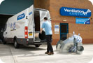 Image of man loading van